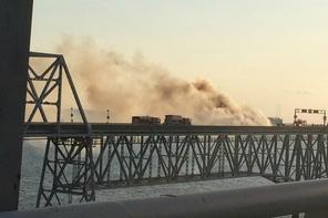 A tractor-trailer hauling mulch caught fire and closed the eastbound span of the Chesapeake Bay Bridge, causing massive tie-ups as the west-bound span was used for one-way traffic. Photo WJLA TV