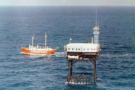 The lightship Chesapeake leaves its duty station off of Cape Henry, Va. as its replacement, the tower rig takes its place. Coast Guard photo