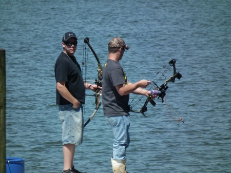 Bow fishing from the bow for skates and snakeheads.  THE CHESAPEAKE TODAY photo