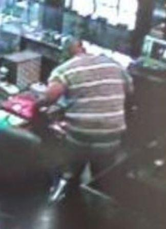 This fat black guy was one of the robbers of the TC Martin Jewelry store in Charlotte Hall, Md, according to the Maryland State Police. The store might want to invest in a better camera system when their insurance company denies their claim due to this lousy shot. The fat guy seen here might want to either go on a diet or get some fashion advise and avoid wearing stripes that wrap around his Whopper size lard butt. Once he is apprehended, he may breathe a sigh of relief to know that the Hotel St. Mary's doesn't outfit their guest in stripes but instead put them in solid orange jumpsuits.