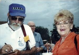 Bill Burton reported on the Great Solomon's Island Fish-In in 1989. Calvert County Commissioner Barbara Stinnett, right, waits while Burton pens a note. THE CHESAPEAKE TODAY photo