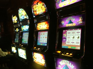 St. Mary's County has a long and recent history with slot machines, with the most recent surge in slots taking place seven years ago as thousands of illegal slot machines spread throughout liquor stores, bars and restaurants, all with using various charities as fronts with no independent accounting of the funds. The charities were gullible and were happy to take the money until the officials managed to get their act together and shut it all down, hauling away scores of slot machines. These slots were lined up in the Brass Rail in Great Mills.  THE CHESAPEAKE TODAY photo