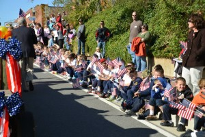 Children show their patriotism and respect for veterans at the annual Veterans Day Parade in Leonardtown. Photo by Tiffany Barthelme for THE CHESAPEAKE TODAY