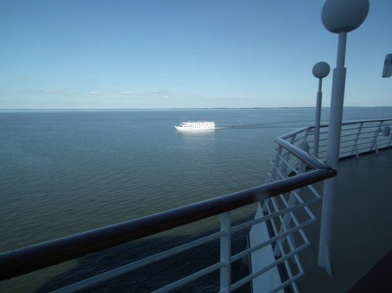 Two of the ways to cruise the Chesapeake Bay, on the American Star shown here from the deck of the Grandeur of The Seas. THE CHESAPEAKE TODAY photo