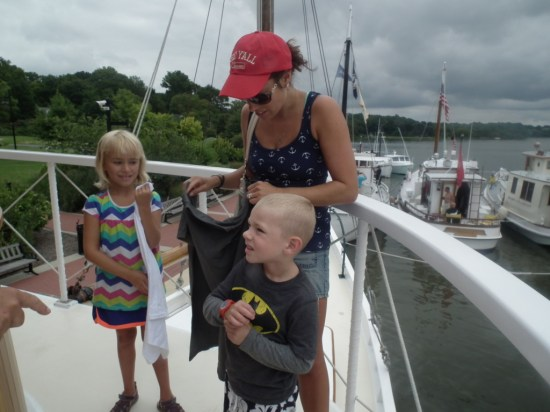 On the Iva W, Eva, Benny and their mom Veronica are treated to tee shirts by the owner. THE CHESAPEAKE TODAY photo