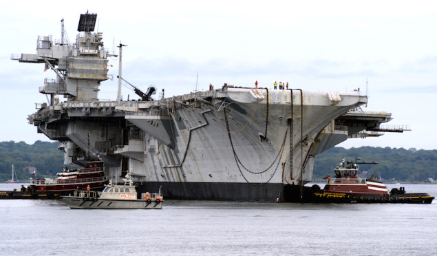 NEWPORT, R.I. (Aug. 21, 2014) The former aircraft carrier USS Saratoga (CV 60) prepares for her final voyage from Newport Naval Station to a dismantling facility in Brownsville, Texas, the aircraft carrier's final resting place. The ship arrived in Newport on Aug. 7, 1998, after spending four years in storage following her decommissioning in 1994. Saratoga was the second carrier of the Forrestal class and completed 22 deployments in her 38-year career. (U.S. Navy photo by Lindsay Church/Released)