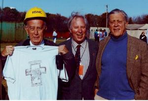 Maryland Gov. William Donald Schaefer holds up his souvenir tee shirt for the Lead Coffins with Burt Kumerrow of the Historic Commission staff, and Ben Bradlee, right.  THE CHESAPEAKE TODAY photo
