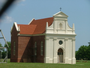 The reconstructed Brick Chapel at St. Mary's City stands on the site of the original chapel which was ordered closed by the British Royal Governor in 1705.  THE CHESAPEAKE TODAY photo