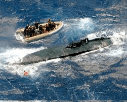 Columbian captain's sub full of cocaine being escorted to shore by U. S. Coast Guard