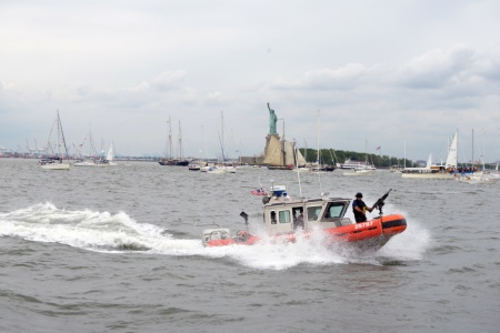 Coast Guard Station New York crew members aboard a 25-foot response boat enforce a security zone during the Lafayette Parade of Ships around the Statue of Liberty, Saturday, July 4, 2015. The parade was held to celebrate the Hermione, an exact replica of Lafayette's liberty ship that ferried the Marquis de Lafayette to America in 1780. (U.S. Coast Guard photo by Petty Officer 3rd Class Alissa Flockerzi)