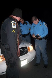 DFC Connelly examines a large knife removed from a suspect.
