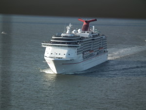 The Carnival Pride is based in Baltimore and runs trips to Bermuda, the Caribbean and the Bahamas. In this photo, the ship passes under the Chesapeake Bay Bridge. THE CHESAPEAKE TODAY photo