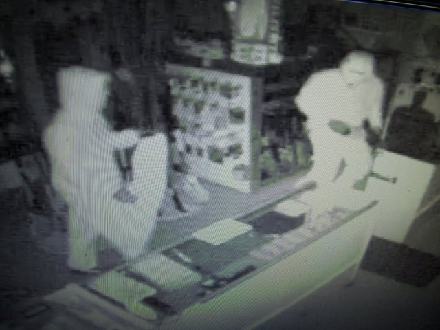 Chespeake Guns burglars nabbed nearly two dozen rifles and handguns in Stevensville heist 121915 Photos courtesy of a 1950's era security system.