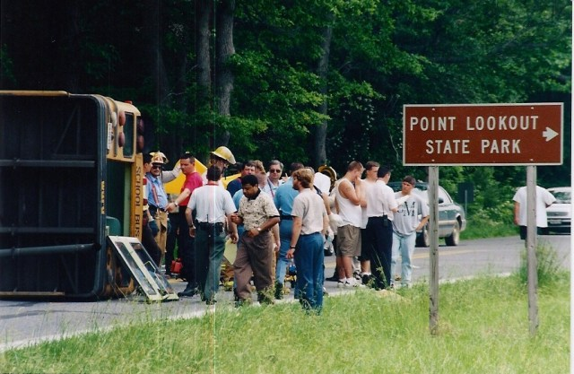 School bus crash at Point Lookout. In spite of this wreck showing the need for the road widening project, the funds were never put in the budget since this photo was taken in the early 1990's. See more of news of the era in THE STORY OF THE RAG http://amzn.to/1Gg8G95