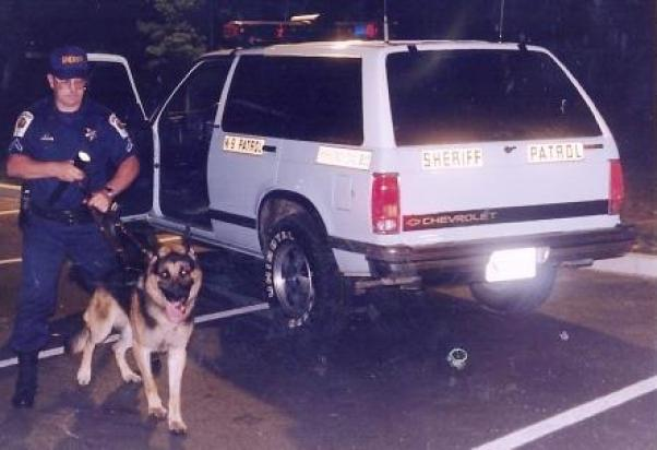 Dep. Bell and Tarras ready to track a suspect in St. Mary's County church burglaries. See more on cops and crime in THE STORY OF THE RAG. http://amzn.to/1Gg8G95