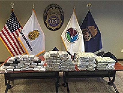 $2.4 million in cash and 31 kilos of cocaine