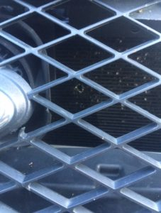 Virginia-State-Police-bullet-holes-in-grill-of-cruiser