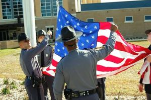 Virginia State Police raise the U. S. flag.