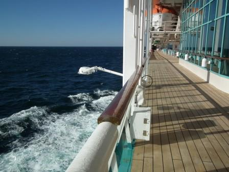 Don't walk on the rail when drinking...or at any other time. This is a typical rail that prevents nearly 20 million cruise passengers each year from taking a dive. THE CHESAPEAKE TODAY photo