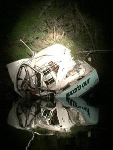 Boat sheared by bridge at night on Curtis Creek Baltimore AACFD