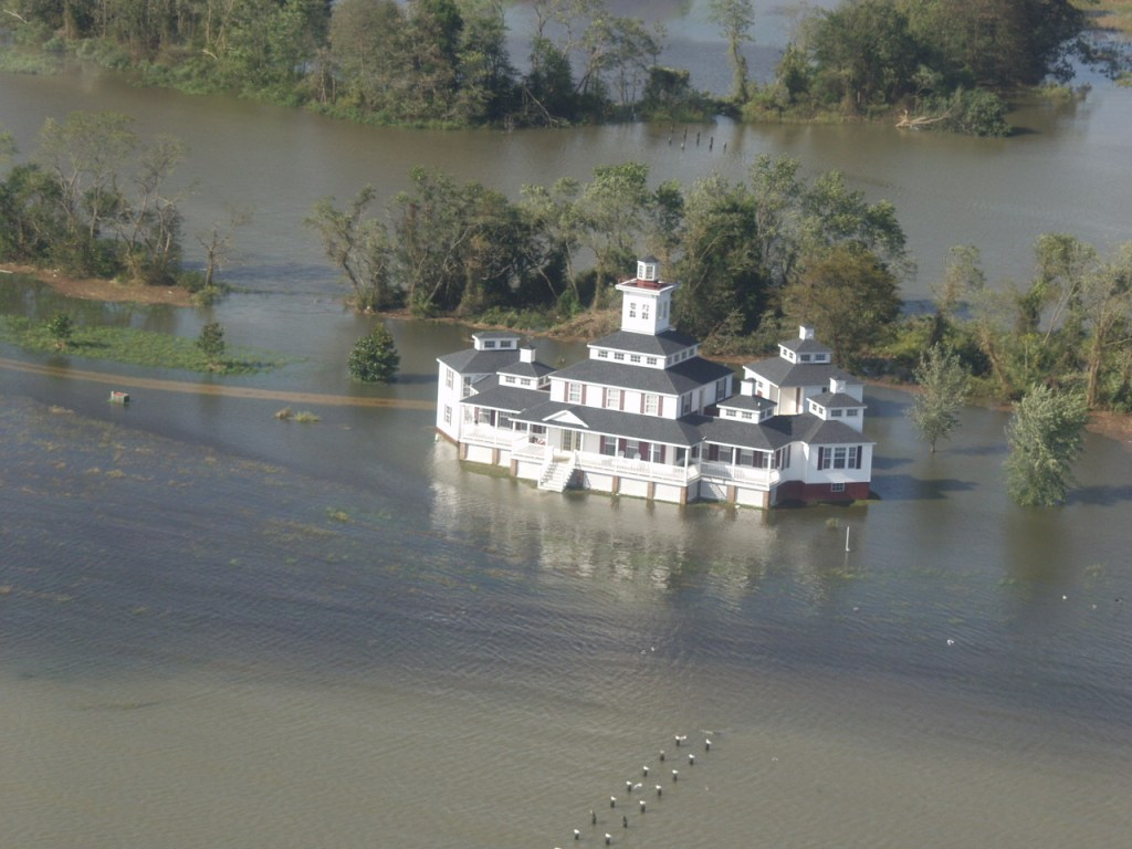 """The owner of this rambling riverfront home might want to name it """"River House"""" with boat parking underneath."""