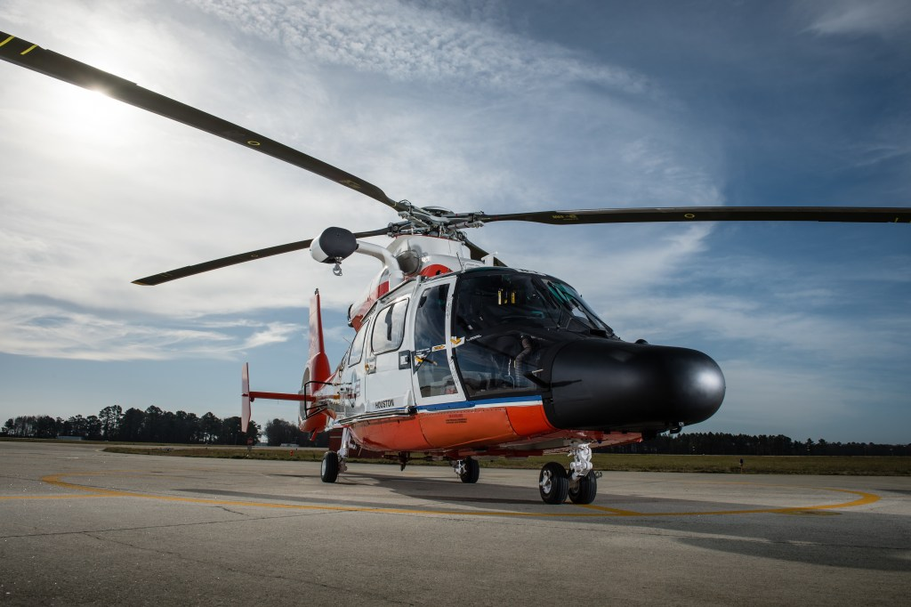 Coast Guard Jayhawk Helicopters stand ready at Air Station Elizabeth City Wednesday, March 10, 2016. Air Station Elizabeth City helicopter crews were at Kill Devil Hills to celebrate the centennial anniversary of the Coast Guard's aviation program with formation flights and a classic painting scheme. (U.S. Coast Guard photo illustration by Auxiliarist David Lau)