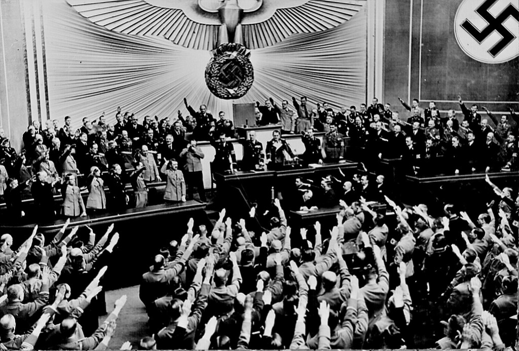 Hitler accepts the ovation of the Reichstag after taking Austria. Next was Czechoslovakian Sudetenland, largely inhabited by a German- speaking population. Berlin, March 1938. 208-N-39843