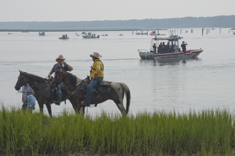 Saltwater Cowboys at 91st annual Chincoteague Island VFD pony roundup Photo by PO 2nd Class Nate Littlejohn