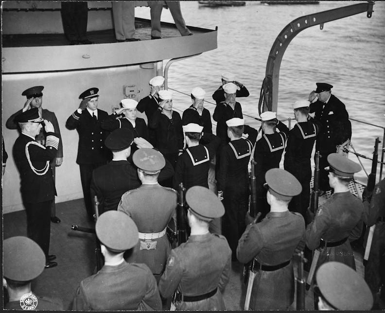 US sailors and Marines render honors to Winston Churchill (Far Right) as he boards a US Naval vessel during FDR's Trip to the Crimea.