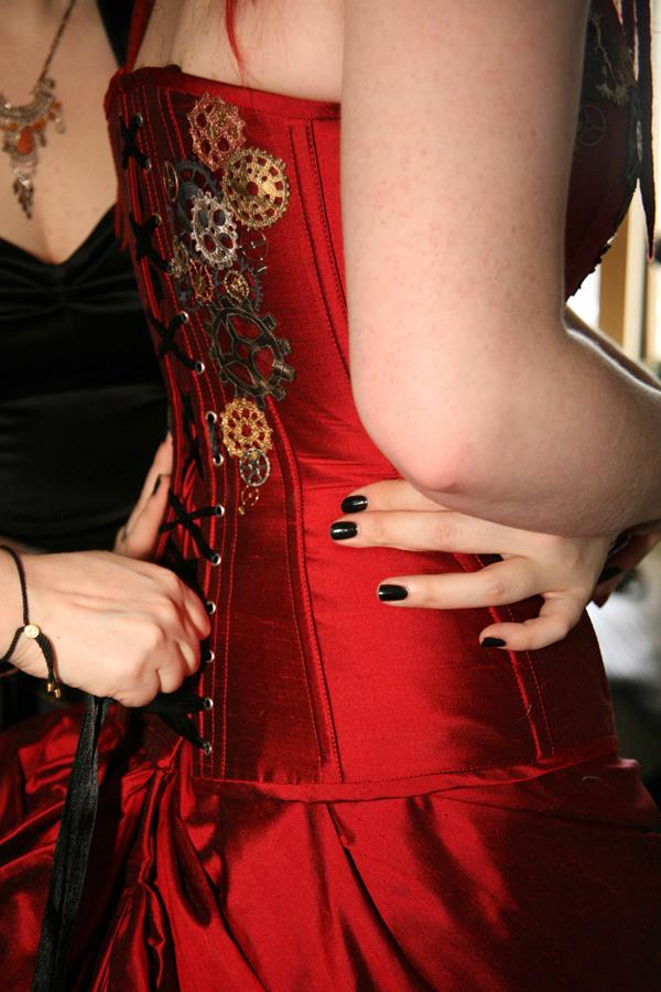 A Ruby Red Black and metallic applique corset for