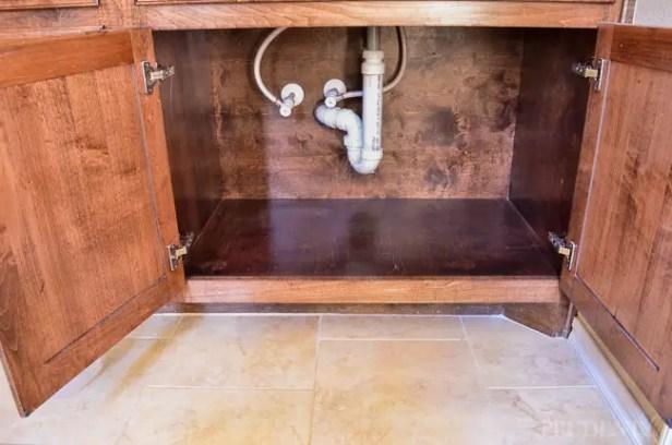 empty kitchen sink cupboard