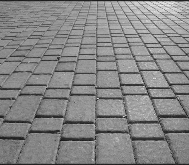 relaying paving to cover a bump or dip