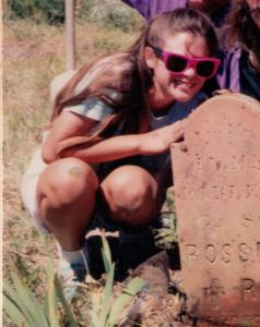 Cleaning a pioneer graveyard during a service project for Young Men and Young Women