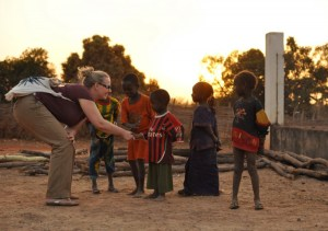 Dana Allison meets some of the local children in a village in Senegal