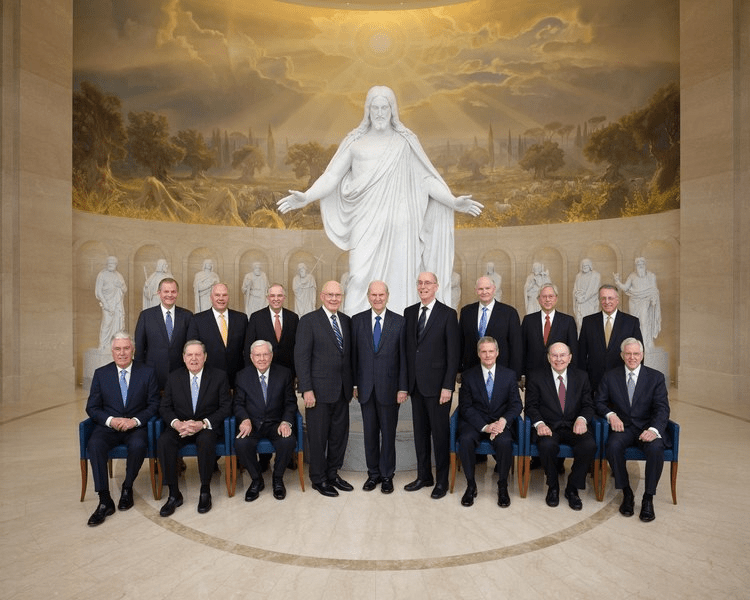 Image of the Quorum of the Twelve and the First Presidency at in front of the Christus Statue at the Rome Temple.