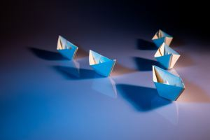 paper boats in v formation
