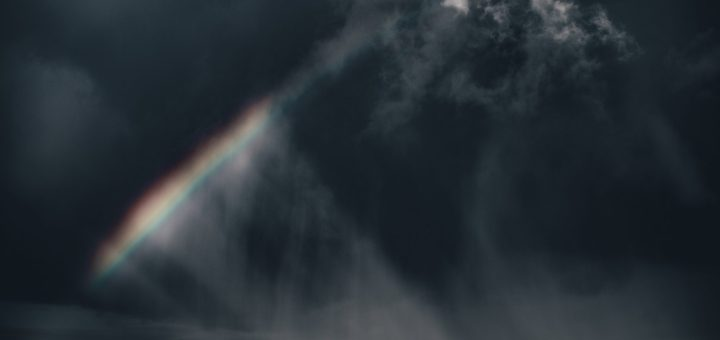 Rainbow against dark clouds