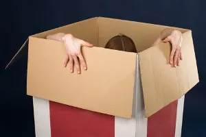 Woman trying to get out of a box © Tatonka   Dreamstime.com