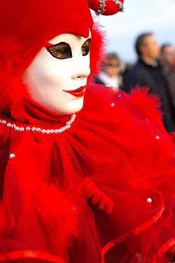 Hiding behind a mask © Luciano Mortula   Dreamstime.com