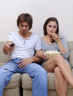 Bored couple on couch © Warrengoldswain | Dreamstime.com