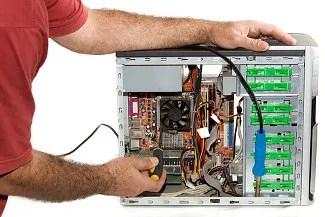 Fixing a computer © Roger Costa Morera   Dreamstime.com