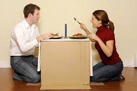 Couple using a box as a table © Christopher Howey | Dreamstime.com