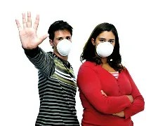 Couple in flu masks © Luis Louro | Dreamstime.com