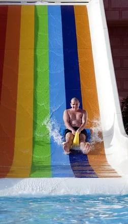 Man on a water slide © Atm2003 | Dreamstime.com