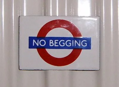 NO BEGGING sign © Annie Mole | flickr.com