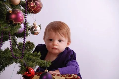 Baby and Christmas tree © Tom Clare | freedigitalphotos.net