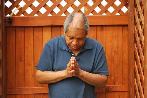 Man Praying © Oscar Williams | Dreamstime.com