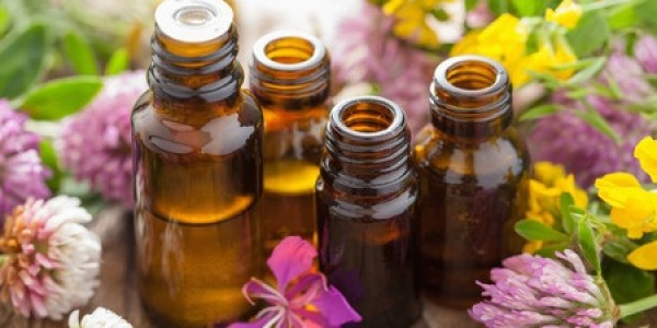 image of essential oils with flowers