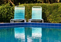 chairs side by pool