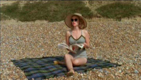 Zoe reading Vogue on the beach